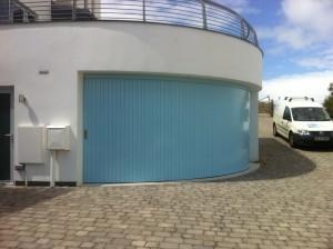Blue curved garage door