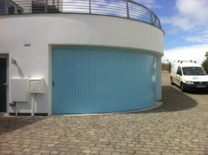 Blue curved garage door