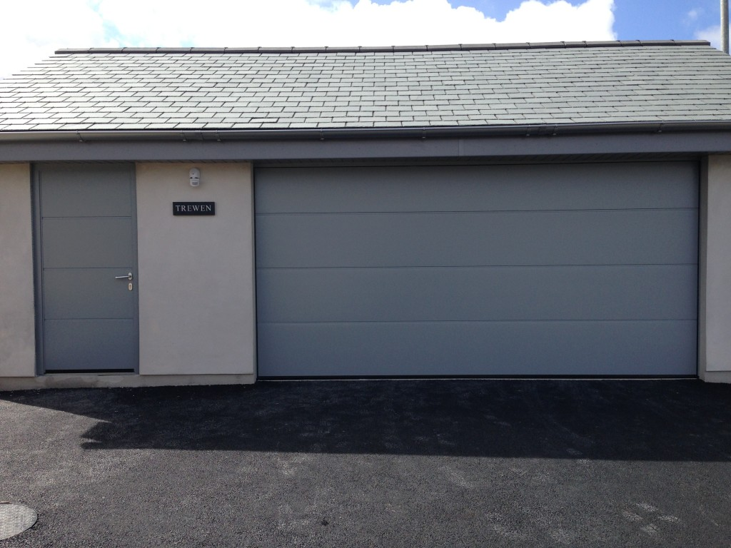 Hormann LPU40 Large ribbed silk grain door with matching side door in storm grey