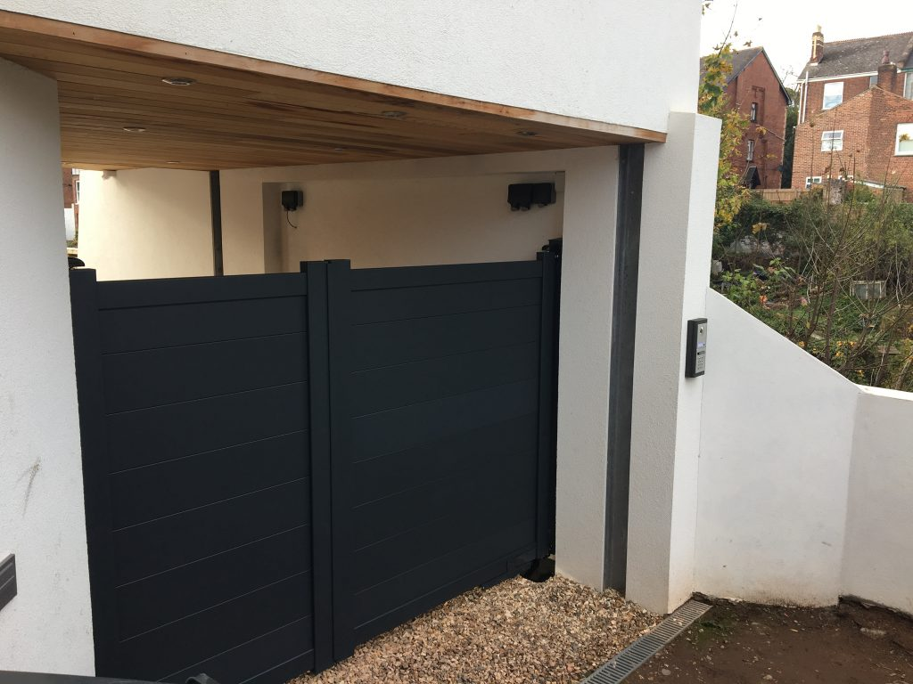 Anthracite Aluminium Gates installed in Exeter with unequal leaves
